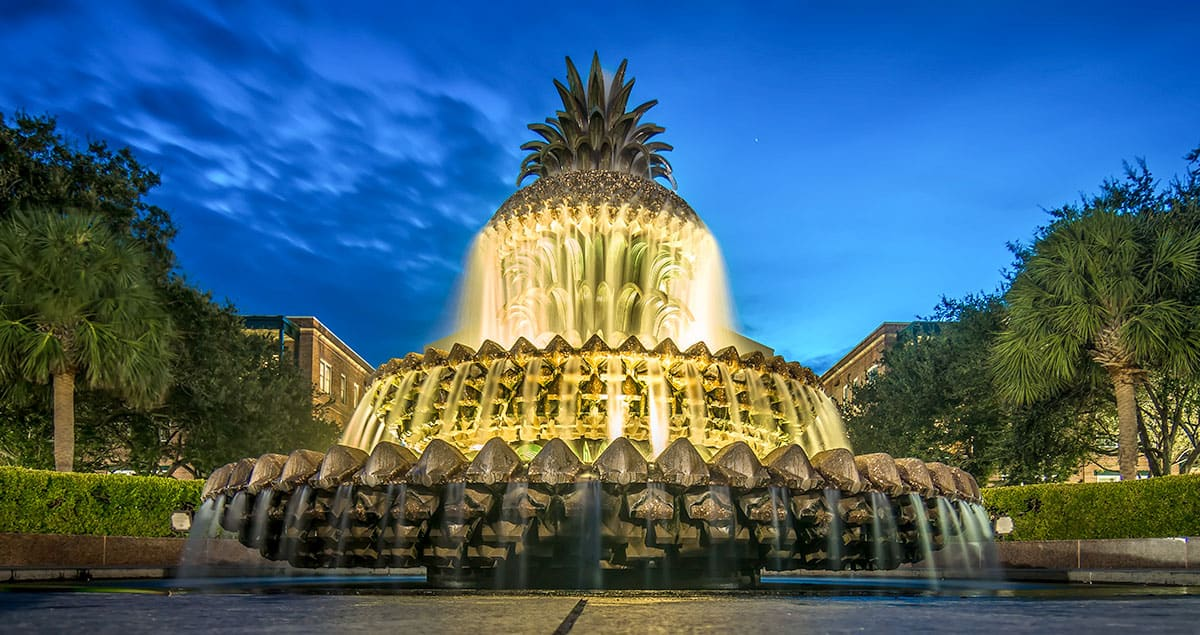 best ghost tours in Charleston South Carolina - Night image of pineapple shaped water fountain